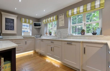 white kitchen with yellow strip blinds