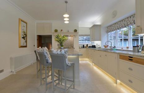 view of kitchen with island and marble worktops