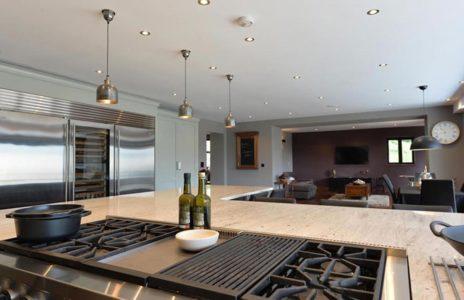 bespoke kitchen island with wooden worktop and overhead spotlights