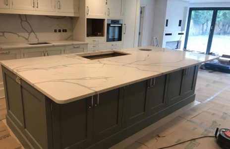 grey wood kitchen island with white marble work surface