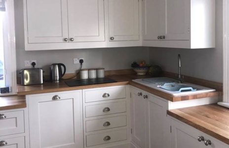 white wooden fitted kitchen worktops with traditional wooden accents