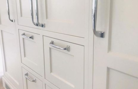 white cupboard doors with silver handles