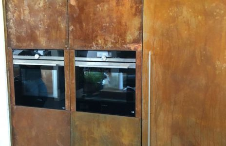 aged wood kitchen storage with built in duel oven