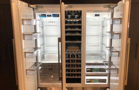 modern silver fridge with open doors and built in wine fridge