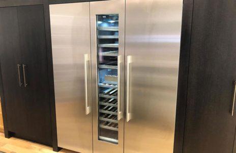 modern two door silver fridge with built in wine fridge