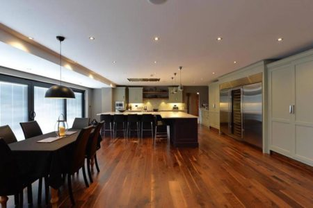 large kitchen with wood flooring