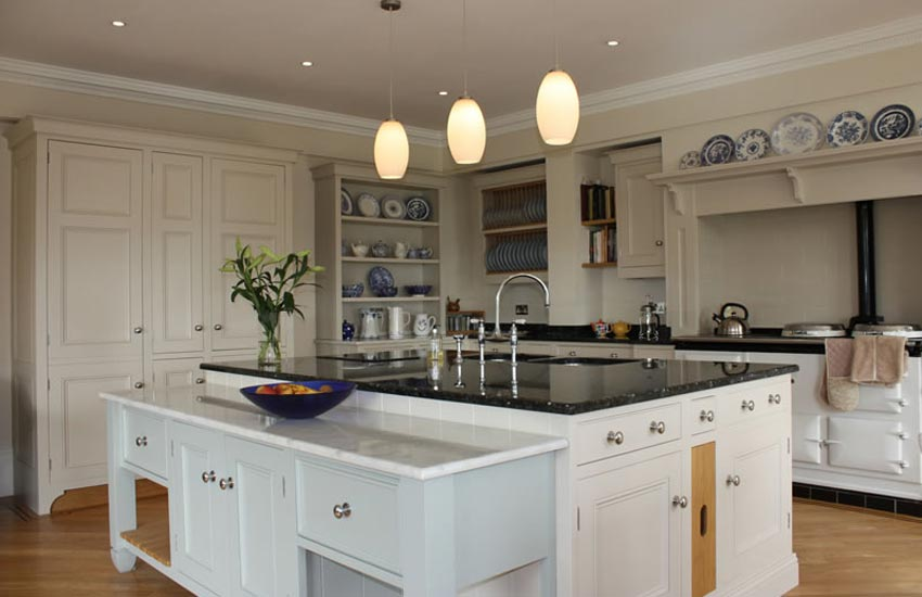 large kitchen with white cupboards