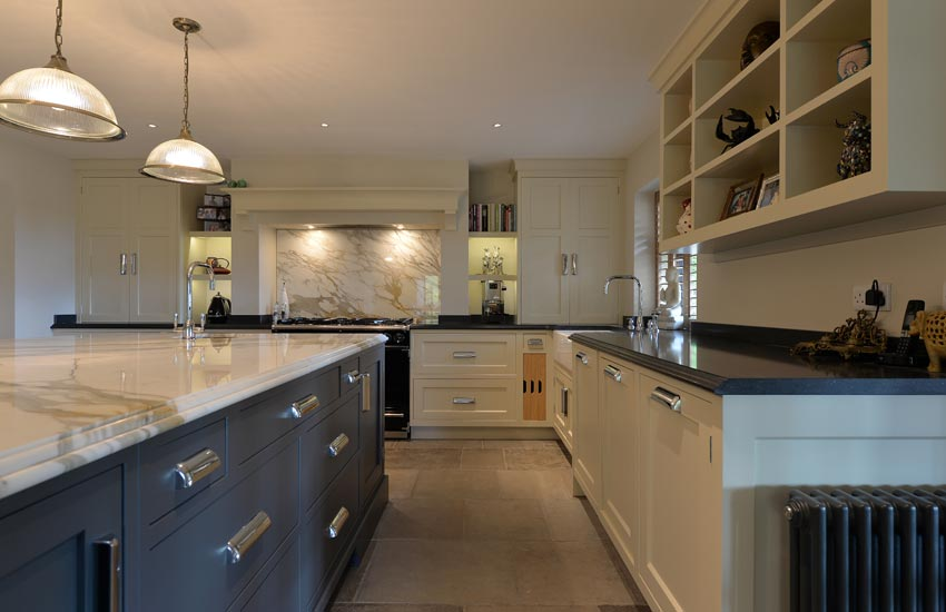 fitted kitchen with blue and white marble worktops