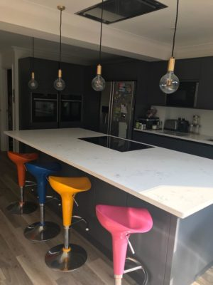 modern kitchen with island and colourful breakfast bar chairs