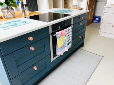 Teal fitted kitchen oven space