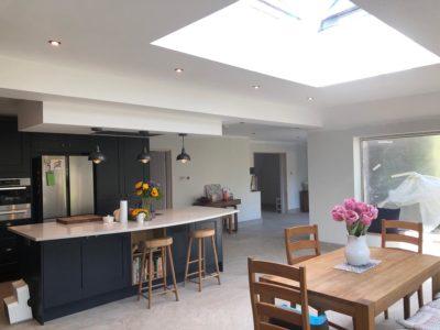dark sleek modern kitchen with diner area