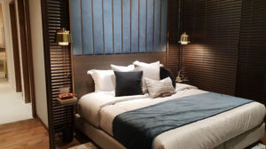 dark bedroom with wooden headboard